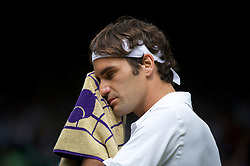 LONDON, ENGLAND - Wednesday, June 29, 2011: Roger Federer (SUI) looks dejected during the Gentlemen's Singles Quarter-Final match on day nine of the Wimbledon Lawn Tennis Championships at the All England Lawn Tennis and Croquet Club. (Pic by David Rawcliffe/Propaganda)