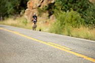 08 September 2013: A rider climbs Left Hand Canyon during the bicycle ride from the front range city of Boulder to the mountain town of Ward via Old Stage Road and Left Hand Canyon in Boulder, CO. ©Brett Wilhelm