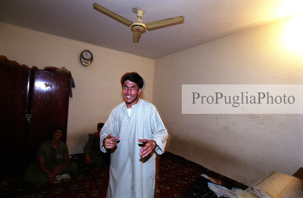 A servant - this is how a housekeeper is called in Afghanistan - having some fun at the Kandahar's Governor house