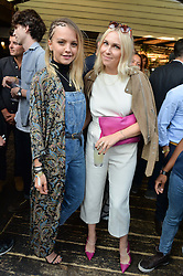 Left to right, LAURA HAYDEN and BECKY TONG at the Warner Music Group Summer Party in association with British GQ held at Shoreditch House, Ebor Street, London E2 on 8th July 2015.
