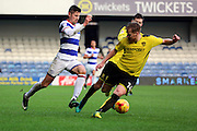 Queens Park Rangers midfielder Pawel Wszolek (15) dribbling past Burton Albion defender Damien McCrory (14) during the EFL Sky Bet Championship match between Queens Park Rangers and Burton Albion at the Loftus Road Stadium, London, England on 28 January 2017. Photo by Matthew Redman.