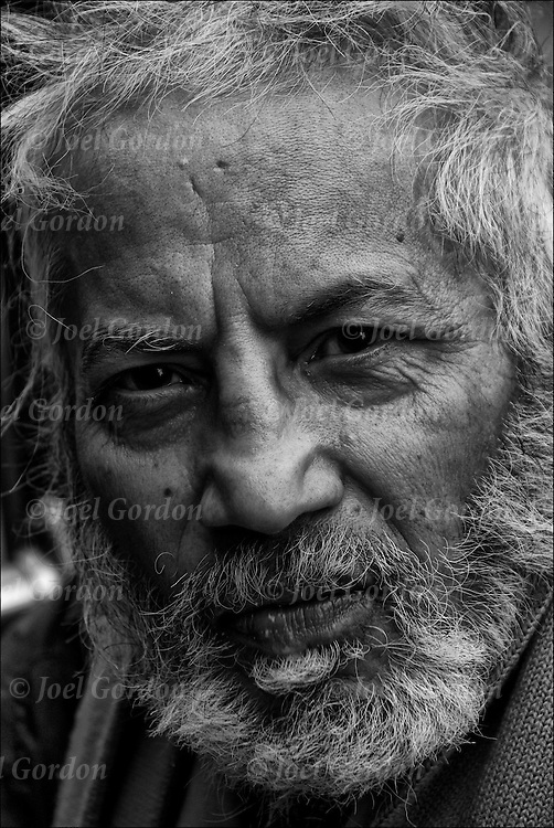 Head and shoulders portrait of Bud a homeless person from Bombay, India.