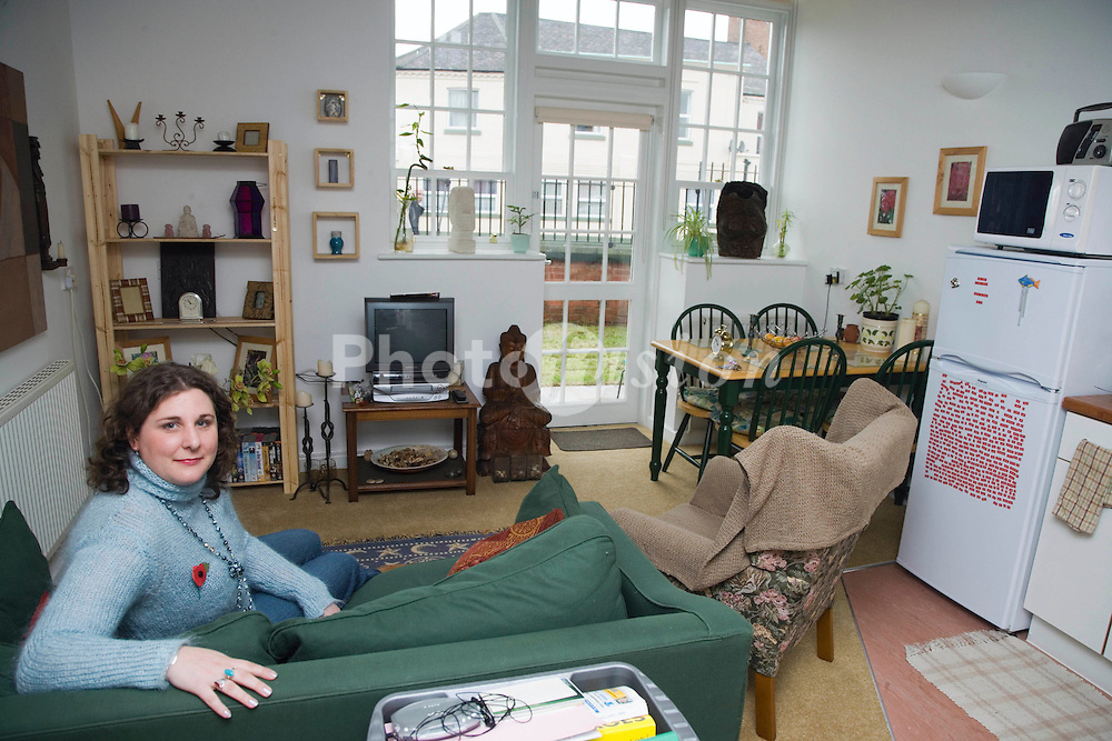 A resident at home in The Guinness Trust's newly opened; once derelict Victorian Parklands Girls School; converted 21 new affordable homes for local people in housing need; central Long Eaton