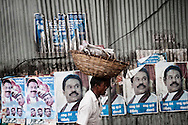 A street vendor walks in front of posters of Sri Lanka's President Mahinda Rajapaksa in Colombo, Sri Lanka, July 2, 2009. With the end of the 26 war between the Sri Lankan government and the LTTE, security in the capital city remains on high alert.