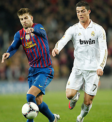 25.01.2012, Stadion Camp Nou, Barcelona, ESP, Copa del Rey, FC Barcelona vs Real Madrid, im Bild Barcelona's Gerard Pique and Real Madrid's Cristiano Ronaldo // during the football match of spanish Copy del Rey, between FC Barcelona and Real Madrid at Camp Nou stadium, Barcelona, Spain on 2012/01/25. EXPA Pictures © 2012, PhotoCredit: EXPA/ Alterphotos/ Cesar Cebolla..***** ATTENTION - OUT OF ESP and SUI *****