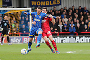 Rhys Murphy forward for AFC Wimbledon (39) and Crawley Town Midfielder Andy Bond (22) tussle during the Sky Bet League 2 match between AFC Wimbledon and Crawley Town at the Cherry Red Records Stadium, Kingston, England on 16 April 2016. Photo by Stuart Butcher.