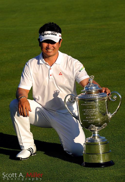 Aug 16, 2009; Chaska, MN, USA; Y.E. Yang (KOR) poses with the Wanamaker Trophy after winning the 2009 PGA Championship at Hazeltine National Golf Club.  ©2009 Scott A. Miller