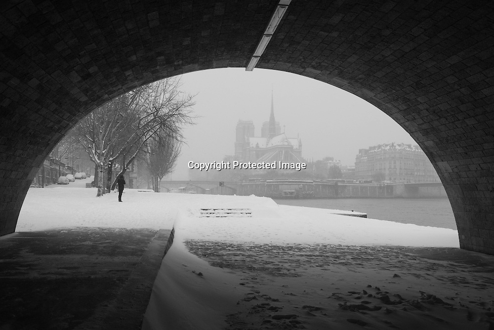 France. Paris. 5th district. under the pont de la Tournelle  , Notre Dame Cathedrale in the distance