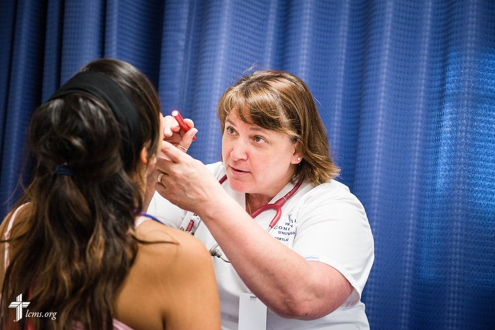 Nursing student Christine Lemieux examines a classmate during a class exercise at Concordia University on Friday, July 11, 2014,  in Portland, Ore. LCMS Communications/Erik M. Lunsford