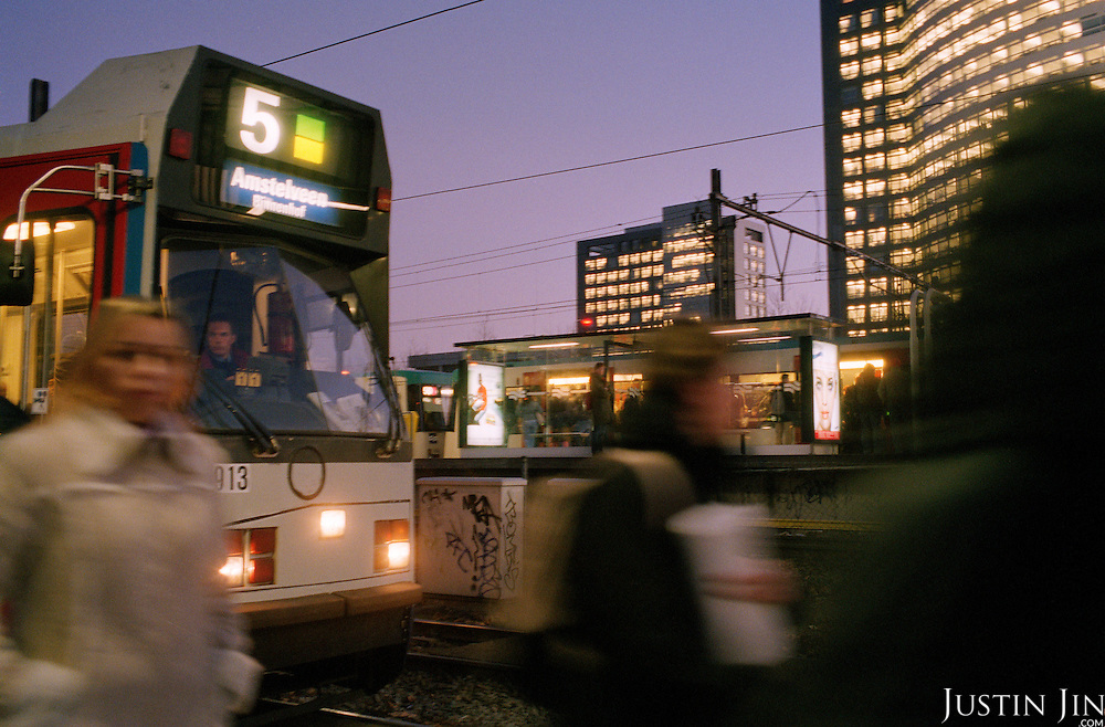 Office workers walk on the Zuid/WTC metro station in Amsterdam during the rush hour..Picture taken 2005 by Justin Jin