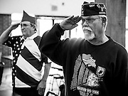 VFW Post 9323 Lake Station members, Nelson Navas (right) and Joe Eakins salute the flag during a Veterans Day ceremony in Lake Station, Indiana.