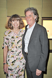 SIR PAUL & LADY SMITH at a private view of Japonisme: From Falize to Faberge held at Wartski, 14 Grafton Street, London on 10th May 2011.