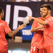 MEADOWLANDS, NEW JERSEY- August 7:   Marco Asensio #20 of Real Madrid is congratulated by team mates   Dani Ceballos #24 of Real Madrid and Sergio Reguilon #29 of Real Madrid after scoring his sides first goal during the Real Madrid vs AS Roma International Champions Cup match at MetLife Stadium on August 7, 2018 in Meadowlands, New Jersey. (Photo by Tim Clayton/Corbis via Getty Images)
