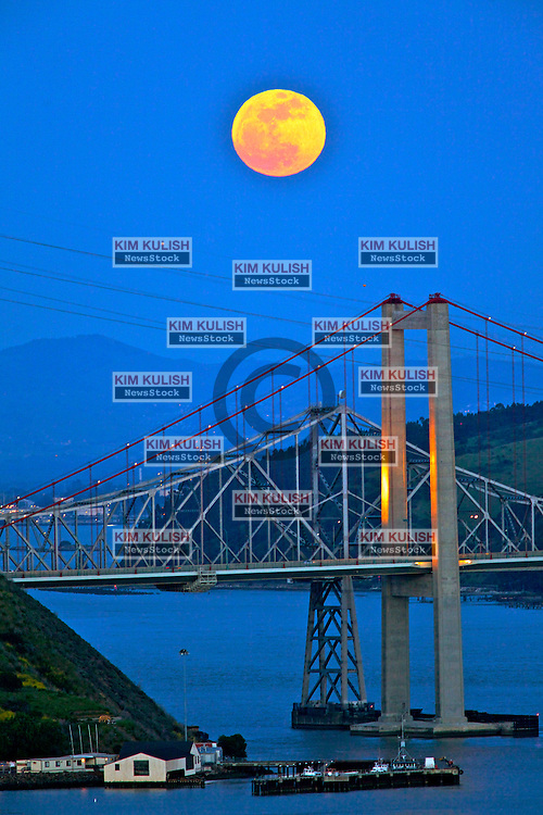"A Perigee Moon rises over the Alfred Zampa Memorial Bridge spanning the Carquinez Strait in Vallejo, California.  The ""Supermoon"" appears 14 percent larger and 30 percent brighter as it makes it's closest approach to the earth this year."