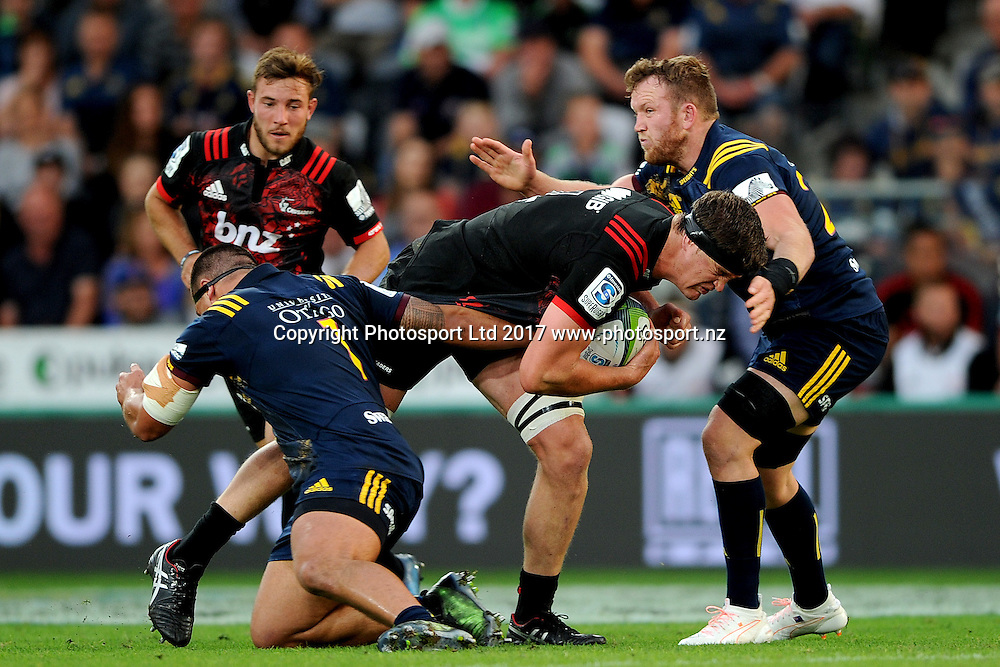 Scott Barrett of the Crusaders runs into the defence during the Super Rugby match between the Highlanders and the Crusaders, held at Forsyth Barr Stadium, Dunedin, New Zealand, on 4th March 2017. Credit: Joe Allison / www.photosport.nz