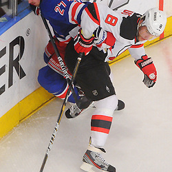 May 14, 2012: New Jersey Devils right wing Dainius Zubrus (8) pins New York Rangers defenseman Ryan McDonagh (27) against the boards during second period action in game 1 of the NHL Eastern Conference Finals between the New Jersey Devils and New York Rangers at Madison Square Garden in New York, N.Y.