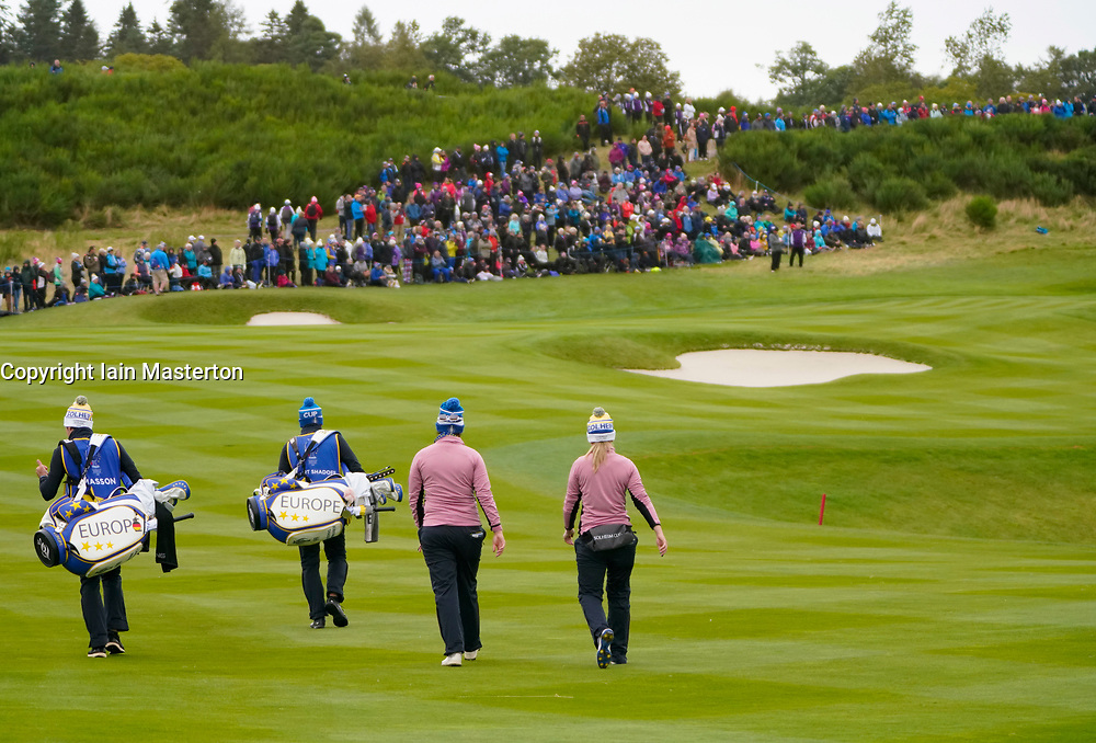 Auchterarder, Scotland, UK. 14 September 2019. Saturday afternoon Fourballs matches  at 2019 Solheim Cup on Centenary Course at Gleneagles. Pictured; Caroline Masson (l) and Jodi Ewart Shadoff of Team Europe walk up the 9th fairway. Iain Masterton/Alamy Live News