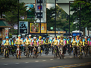 11 DECEMBER 2015 - BANGKOK, THAILAND:  His Royal Highness Crown Prince MAHA VAJIRALONGKORN, the heir apparent to the Thai crown, (2nd from left, red bike, short sleeves, blue gloves) leads the Bike For Dad bike ride in Bangkok. More than 527,000 people registered for the Bike for Dad event to honor Bhumibol Adulyadej, the King of Thailand, whose birthday is also celebrated as Father's Day in Thailand. In Bangkok, 99,999 people registered for Bike for Dad. More than 418,000 people registered for Bike for Dad rides in the provinces outside Bangkok and 9,805 participated in Bike for Dad events outside of Thailand. The Bangkok route was 29 kilometers long (18 miles) and traveled through Bangkok and across the Chao Phraya River into Thonburi. Bike for Dad events were held across Thailand.    PHOTO BY JACK KURTZ