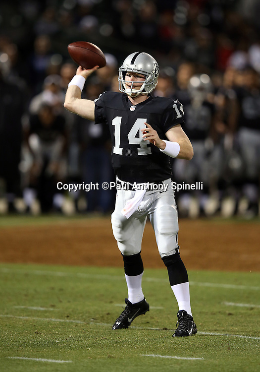 Oakland Raiders quarterback Matthew McGloin (14) throws a fourth quarter touchdown pass that cuts the Chicago Bears lead to 34-26 during the NFL preseason week 3 football game against the Chicago Bears on Friday, Aug. 23, 2013 in Oakland, Calif. The Bears won the game 34-26. ©Paul Anthony Spinelli
