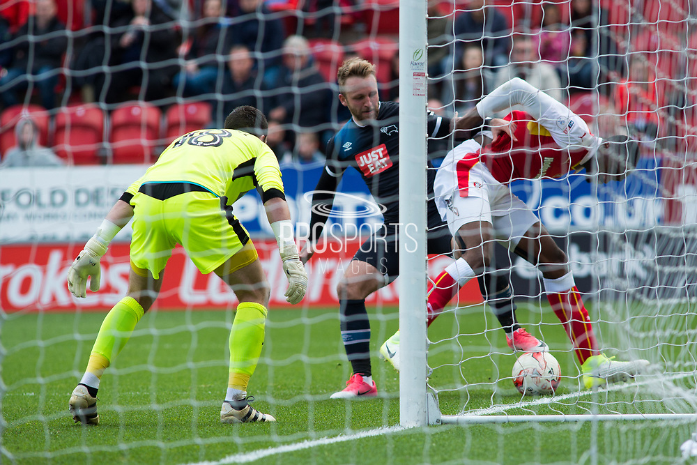 Rotherham United Defender Semi Ajayi holds off Derby County Forward Johnny Russell during the EFL Sky Bet Championship match between Rotherham United and Derby County at the AESSEAL New York Stadium, Rotherham, England on 7 May 2017. Photo by Craig Zadoroznyj.