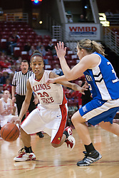 26 February 2006:  Tiffany Hudson begins a drive past Kelsey Crites.....Illinois State Redbirds out muscled the Creighton Bluejays on Senior day by a score of 75-61.  Senior Holly Hallstorm grabbed her 10th double double with 20 points and 12 rebounds.  Competition took place at Redbird Arena on Illinois State University campus in Normal Illinois.