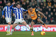 Abel Hernández (Hull City) tries to get a shot off under pressure from the Sheffield Wednesday defender, Kieran Lee (Sheffield Wednesday) during the Sky Bet Championship match between Hull City and Sheffield Wednesday at the KC Stadium, Kingston upon Hull, England on 26 February 2016. Photo by Mark P Doherty.
