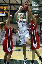 29 January 2011: Stacey Arlis gets fouled by Diana Jacklin during an NCAA Womens basketball game between the Carthage Reds and the Illinois Wesleyan Titans at Shirk Center in Bloomington Illinois.