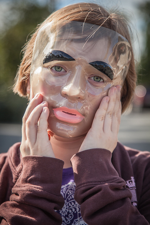Young girl wearing garage sale mask.  My 12 year old neighbor Julianne Risinger in Anchorage's South Addition neighborhood.
