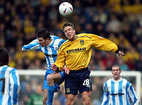 Photo: Scott Heavey.<br />Oxford United v Huddersfeild Town. Nationide Division Three. 06/03/2004.<br />Barry Quinn of Oxford beats Andy Holdsworth (L) in  the air