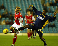 Photo. Chris Ratcliffe<br />Wimbledon vRotherham . FA Nationwide 1st Division. 06/12/2003<br />mikele leigertwood of wimbledon clips the ball away from martin butler of rotherham