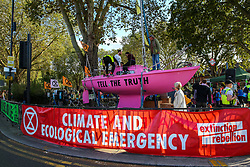 "© Licensed to London News Pictures. 08/09/2019. London, UK. The pink ""Tell the Truth"" boat outside Ducketts Common in north London. Hundreds of Extinction Rebellion climate change activists march from Turnpike Lane station to Manor House Rebellion in north London. Photo credit: Dinendra Haria/LNP"