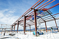 Construction workers secure metal beams to the roofing structure of the KTEC building Monday at the site near Rathdrum.