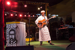 Haile Israel plays music for the audience.  20th Annual Bordeaux Farmers Rastafari Agricultural & Cultural Vegan Food Fair.  Bordeaux Farmers Market.  St. Thomas, USVI.  14 January 2017.  © Aisha-Zakiya Boyd