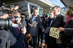 © Licensed to London News Pictures. 21/03/2018. London, UK. Conservative MP and prominent Brexiteer Jacob Rees-Mogg meets fisherman from the 'Fisherman for Leave' campaign on Embankment Pier, London. Fishermen, many of whom who voted for Britain to leave the EU, are angry at yesterday's announcement that Britain will effectively continue to be involved in the EU's Common Fisheries Policy. Photo credit : Tom Nicholson/LNP