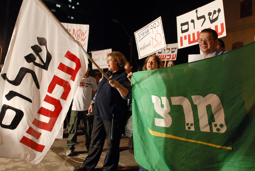 "TEL AVIV, ISRAEL - December 08, 2009 : Israeli left wing activists protested Tueaday evening outside the ministry of defence in Tel Aviv  against what they call ""the recent settler violence in response to announced Freeze' and  demanded that the government enforce the law and create a real settlement freeze. Photo by Gili Yaar?"