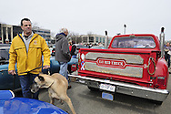 Some people brought their dogs, such as this Great Dane near the Dodge Li'l Red Truck with dual exhaust with vertical stack-pipes, to the 58th Annual Easter Sunday Vintage Car Parade and Show sponsored by the Garden City Chamber of Commerce. Hundreds of authentic old motorcars, 1898-1988, including antiques, classic, and special interest participated in the parade.