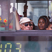 Cubans manage their daily life wether waiting for and riding overcrowded busses or doubling up on old classic cars and motorcycles. <br /> Photography by Jose More