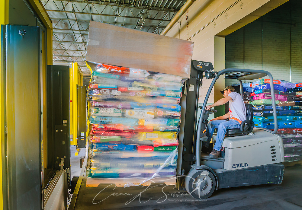 Dustin Baker, assistant manager of Hollywood Feed, loads a pallet of dog food at the company's headquarters, Sept. 3, 2015, in Memphis, Tenn. Hollywood Feed specializes in premium food and products for dogs and cats. The company decided to lease their own fleet of Mack Pinnacle trucks to take their distribution to the next level. (Photo by Carmen K. Sisson/Cloudybright)