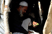 Sexagenarian Imam Hussain is making Paan (Betel-nut) after finished his lunch under his makeshift camp at the outskirts of Delhi State of India. <br /> More than 10,000-numbers of Burmese Rohingya Muslim refugee took shelter in Indian (Hyderabad) Andhra Pradesh, (Mewat) Haryana, (Kanchankunj) Delhi and Jammu States after ethnic strife between Rohingya Muslims and Buddhists that had been started since 1940s. Still so many peoples of aforesaid community have been living at various refugee camps in Myanmar, Bangladesh and India chiefly. Rohingya Muslims of Buthidaung, Rathedaung and Sittwe of Rakhine (formerly, Arakan) State, who ran away from Myanmar (that is, Burma) to Bangladesh to India and others South-Asian countries to escape socio-political-religious violence. (Photo/Shib Shankar Chatterjee)