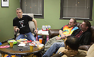 Nick Rhoades (left) talks during a PITCH meeting in Waterloo, Iowa on Thursday, November 7, 2013. PITCH, which stands for Positive Iowans Taking Charge, is a group of HIV+ people who meet together. Seven people attended the meeting.