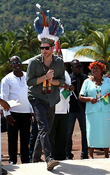Prince Harry wears a traditional head dress during a visit to Surama village in the Hinterland, Guyana during his 15 day tour of the Caribbean.