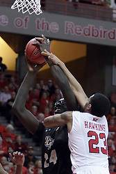 "20 March 2017:  Deontae Hawkins(23) gets all over 7'6"" Tacko Fall trying to stop his shot during a College NIT (National Invitational Tournament) 2nd round mens basketball game between the UCF (University of Central Florida) Knights and Illinois State Redbirds in  Redbird Arena, Normal IL"