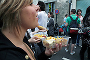 young adult female holding a box with French fries with mayonaise