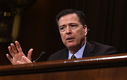 May 3, 2017 - Washington, District of Columbia, U.S. - FBI Director JAMES COMEY testifies before the U.S. bipartisan Senate Judiciary Committee hearing on Capitol Hill. Comey on Wednesday defended his decision to announce a new investigation into Democratic presidential candidate Hillary Clinton's emails while staying quiet on the Trump-Russia one prior to the 2016 U.S. elections. (Credit Image: © Bao Dandan/Xinhua via ZUMA Wire)