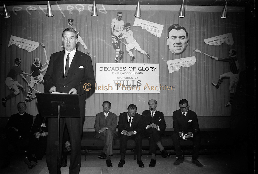 "17/05/1966<br /> 05/17/1966<br /> 17 May 1966<br /> Book reception for ""Decades of Glory: A Comprehensive History of the National Game"" by Raymond Smith.<br /> This reception was held in the offices of W.D. & H.O. Wills to honour the well known author and journalist, Raymond Smith. His book on the history of Hurling (""Decades of Glory"") has just been published with the assistance of Wills of Dublin and Cork and the Central Council of the G.A.A.<br /> Mr. D.R. Mott, the Managing Director of Wills speaking at the reception."