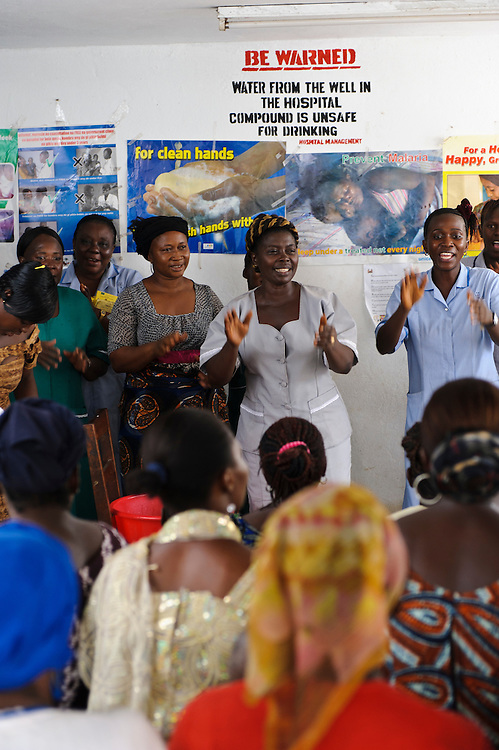 Using theatre and song, staff at the Ola During Hospital demonstrate hand washing techniques for World Hand Washing Day, Freetown, Sierra Leone. The Welbodi Partnership works to support the Ministry of Health and Sanitation in Sierra Leone to deliver high quality paediatric care.  The work of the charity is designed to stimulate lasting change, whether through one-time investments with long-term benefits, or ongoing engagement around key issues, and the charity's long-term commitment is reflected in its approach to funding - their aim is to establish an endowment fund for the hospitals with which they work..The charity's work is conceived, designed, led and implemented by local partners. Hospital staff in Sierra Leone often already know the best solutions to the numerous problems they face, and where they don't, they are the best judges of new ideas. So the role of the Welbodi Partnership is to coordinate funding, international expertise and local know-how to facilitate improvements in the delivery of health care.  They also work to build relationships and consensus with leaders within the Government of Sierra Leone, local health facilities, donors, NGOs and international partners..Welbodi Partnership works to instil a culture of innovation and excellence with partners and their team of experts. They constantly question the assumptions that underlie their work and the tools that they use, evaluate their efficacy and adapt what they do appropriately.