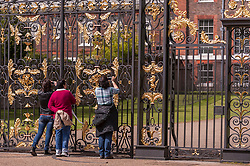© Licensed to London News Pictures. 03/05/2015. London, UK. Tourists takes photos outside the Golden Gates at Kensington Palace as the nation waits for news of the name for the new daughter of the Duke and Duchess of Cambridge who was born the previous day. Photo credit : Stephen Chung/LNP
