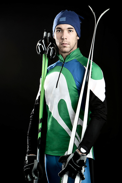 Studio portrait of a cross-country skier in his 20s.