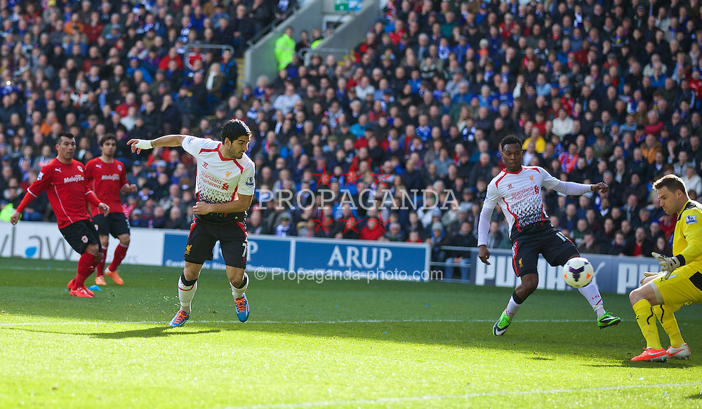 CARDIFF, WALES - Saturday, March 22, 2014: Liverpool's Luis Suarez scores the first goal of his hat-trick against Cardiff City during the Premiership match at the Cardiff City Stadium. (Pic by David Rawcliffe/Propaganda)