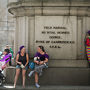 Three generations of women take a breast feeding break at the Procession event  June 10th 2018, Central London, United Kingdom. Procession was a mass participation artwork produced by Artichoke and commissioned by 14-18 NOW. The event took place at the centenary of the women over the age of 30 getting the right to vote.